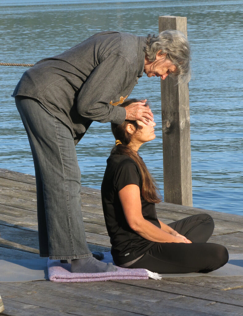 Mothers Healing Together Yoga on the dock of Wiawaka Holiday House on Lake George led by Kathleen Fisk. Attended by Robin Botie of Ithaca, New York, and other bereaved mothers from all over New York.