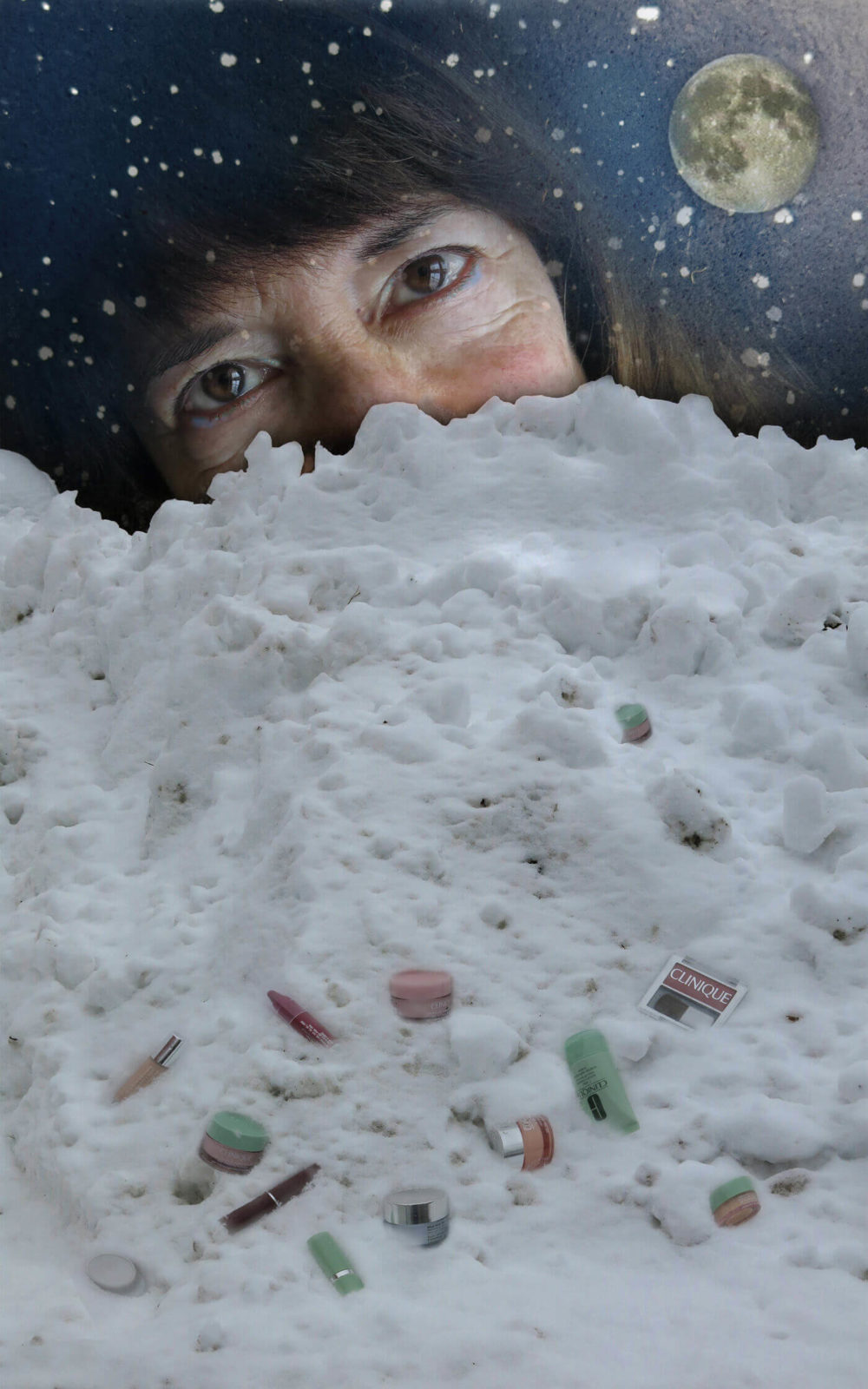 Robin Botie of Ithaca, New York, made up with iridesent eye shadow, watching the moon from behind piles of snow