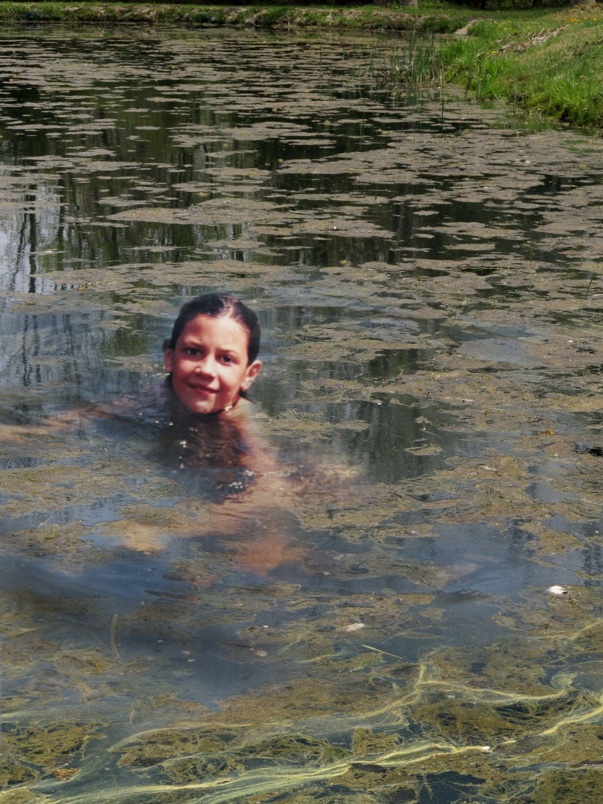 Robin Botie in Ithaca, New York Photoshops daughter, Marika Warden, swimming in pond filled with algae.