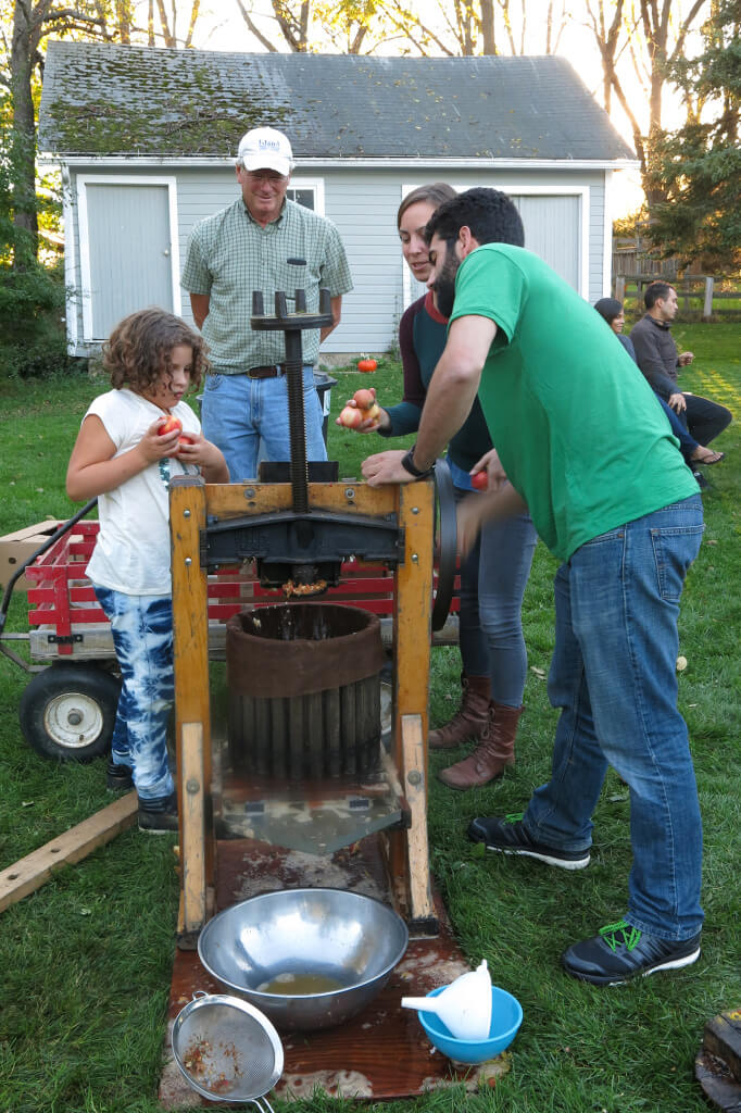 Robin Botie of Ithaca, New York, photographs an apple cider pressing party.