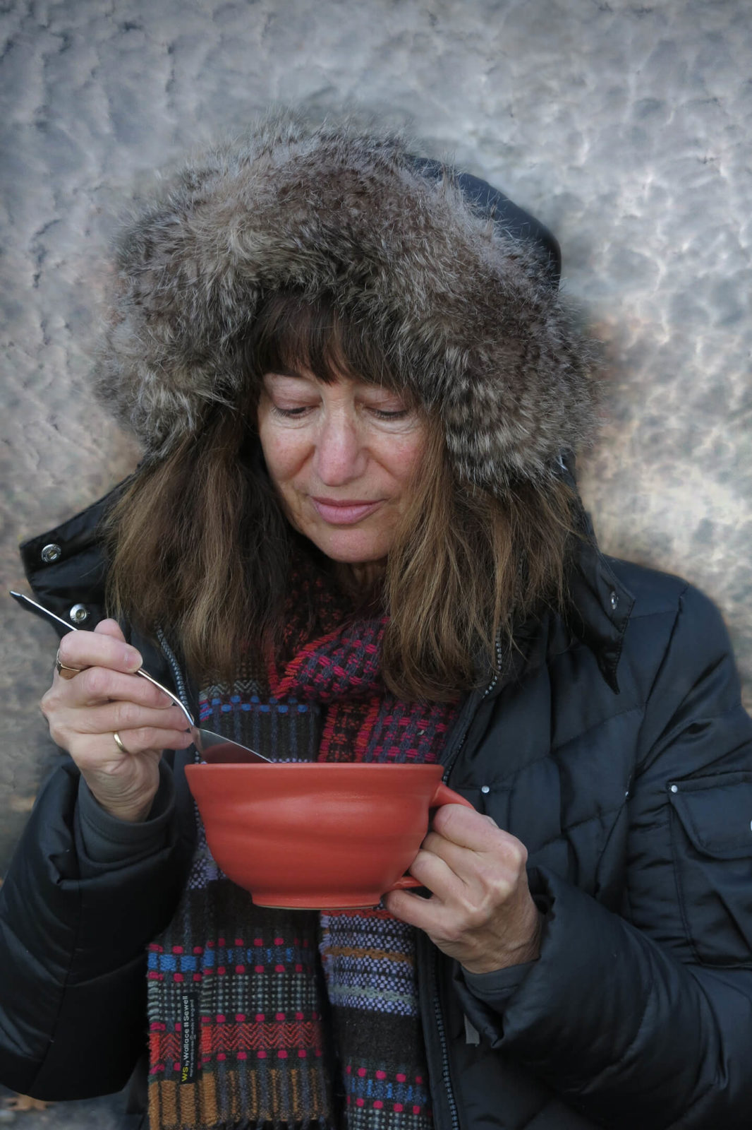 Robin Botie of Ithaca, New York, savors her storm food, a bowl of hearty stew.