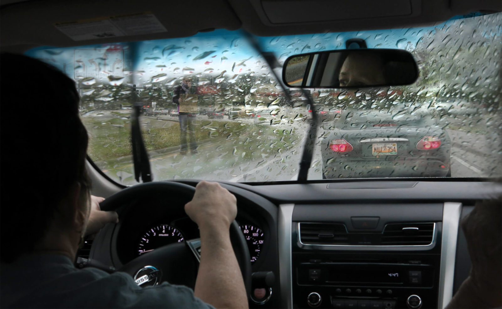 Driving home in the rain, Robin Botie of Ithaca, New York, finds a homeless person in rush hour traffic.