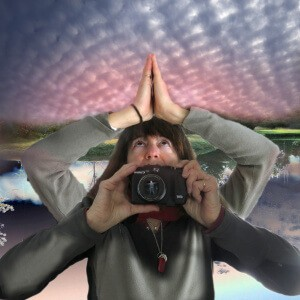 Robin Botie of Ithaca, New York, photoshops selfie, grieving and being grateful under a mackerel sky.