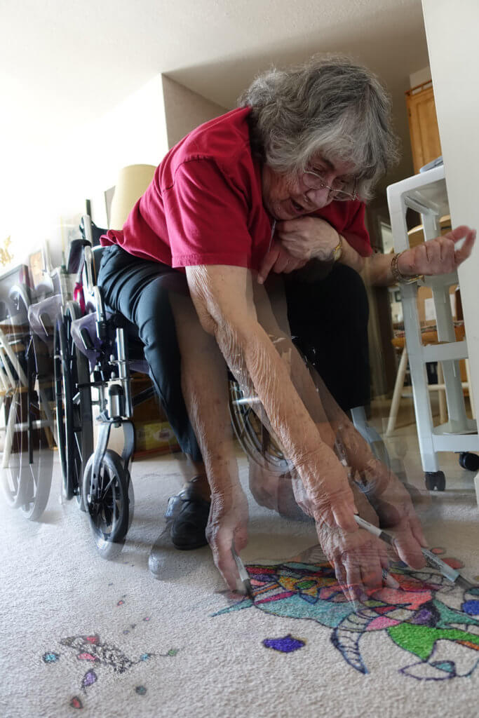 Robin Botie of Ithaca, New York, photoshops an old friend joyfully painting her carpet from a wheelchair.