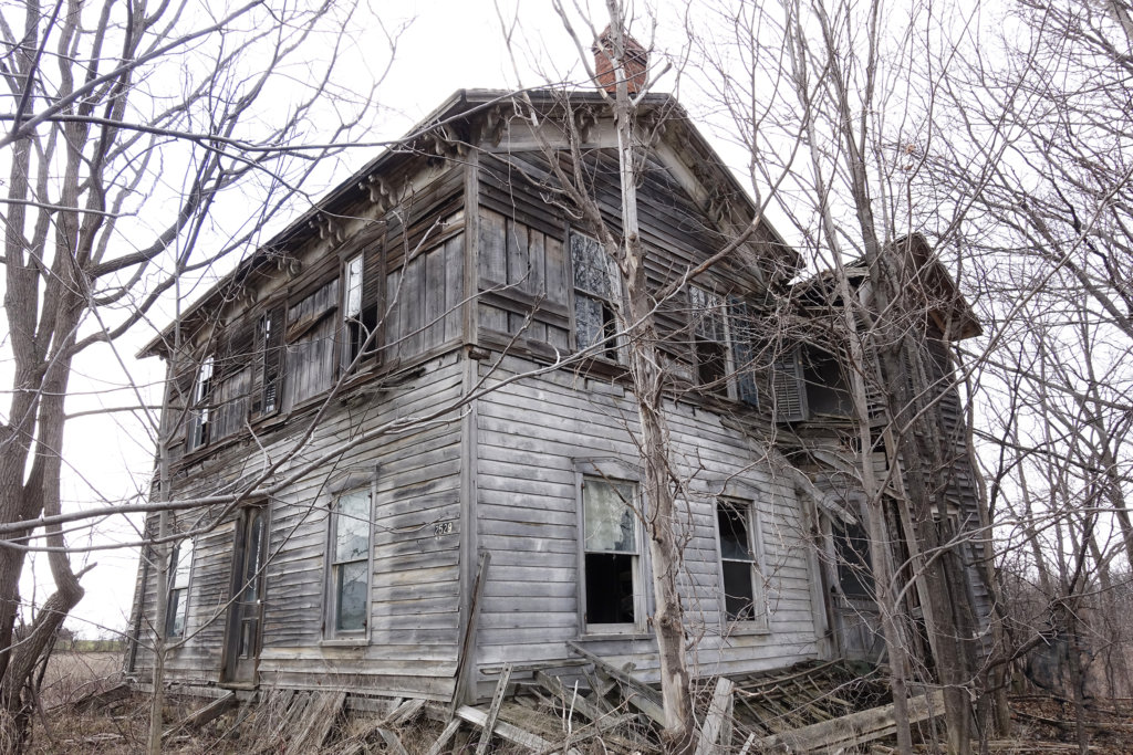 Robin Botie of Ithaca, New York, photographs an abandoned farmhouse somewhere off NY route 96 near Ovid while on a photography field trip with the Finger Lakes Photographers.