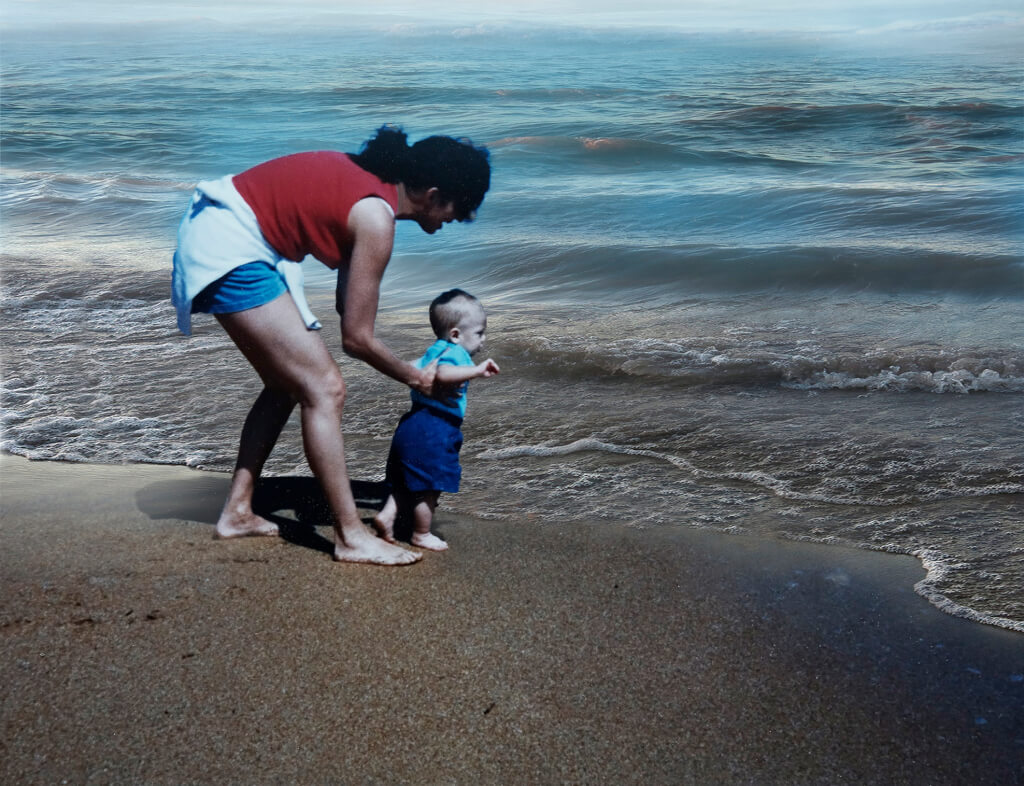 Robin Botie of ithaca, New York, restores an old photograph of herself showing her young son an ocean, in Photoshop.