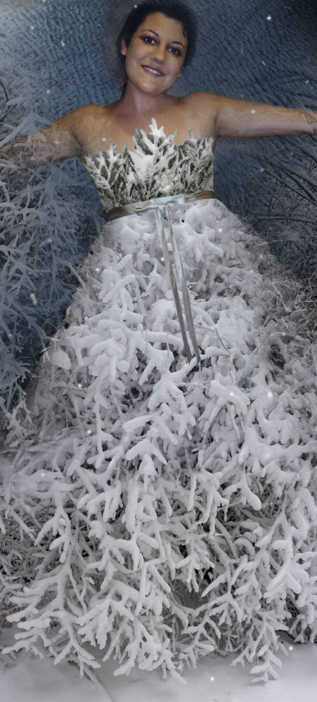 Robin Botie of Ithaca, New York, photoshops a picture of her deceased daughter Marika Warden with a new dress composed of photos of trees in snow, on the angelversary of her death.