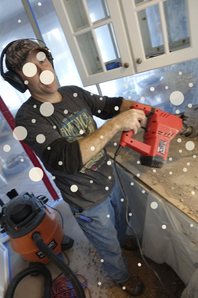 Robin Botie of Ithaca, New York, photoshops her new construction project, her way of dealing with depression and grief during the holiday season.