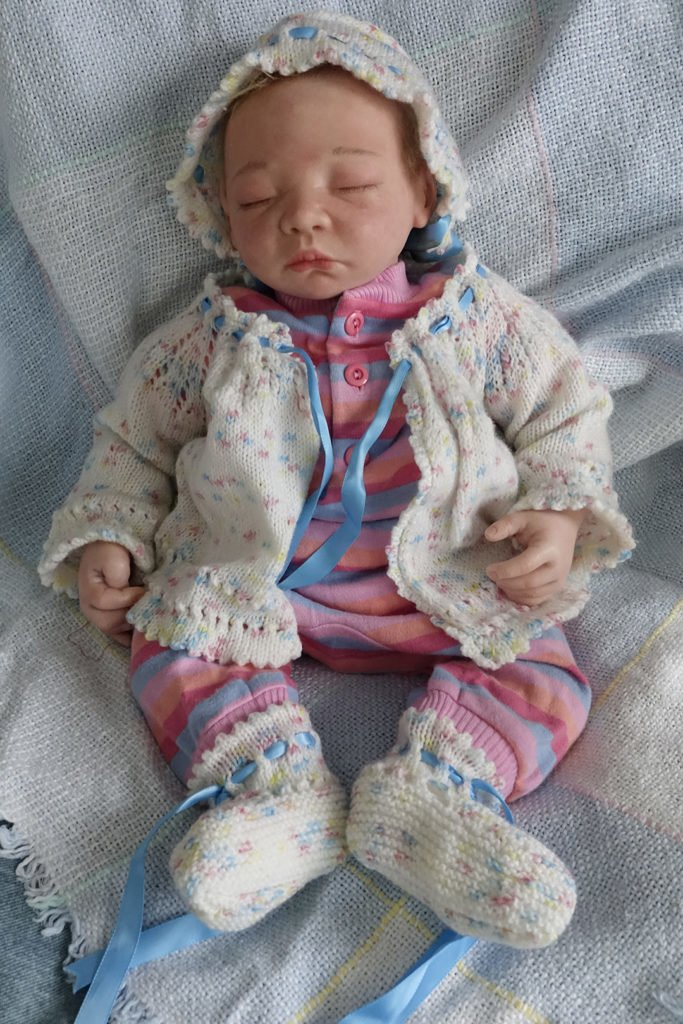 Robin Botie of Ithaca, New York, photoshops a baby doll and invites her readers to take a break and baby yourself.