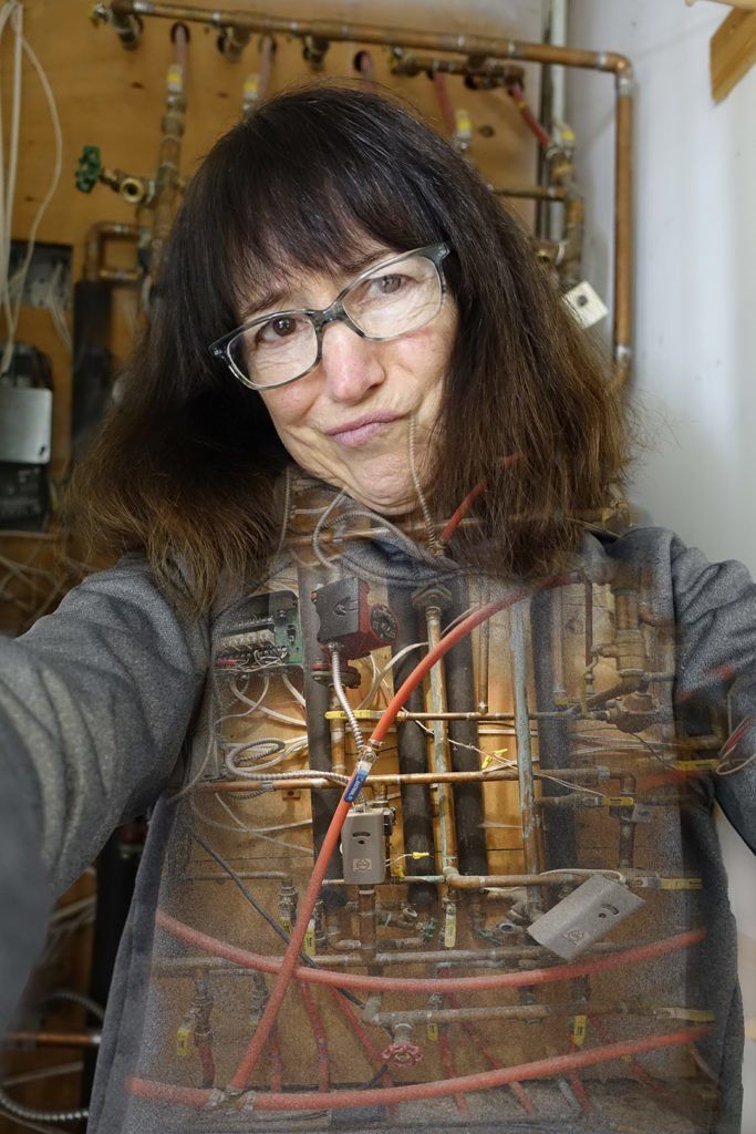 Robin Botie of Ithaca, New York photoshops her old heating system as she puts in new heat pumps and hopes to live to be 100.